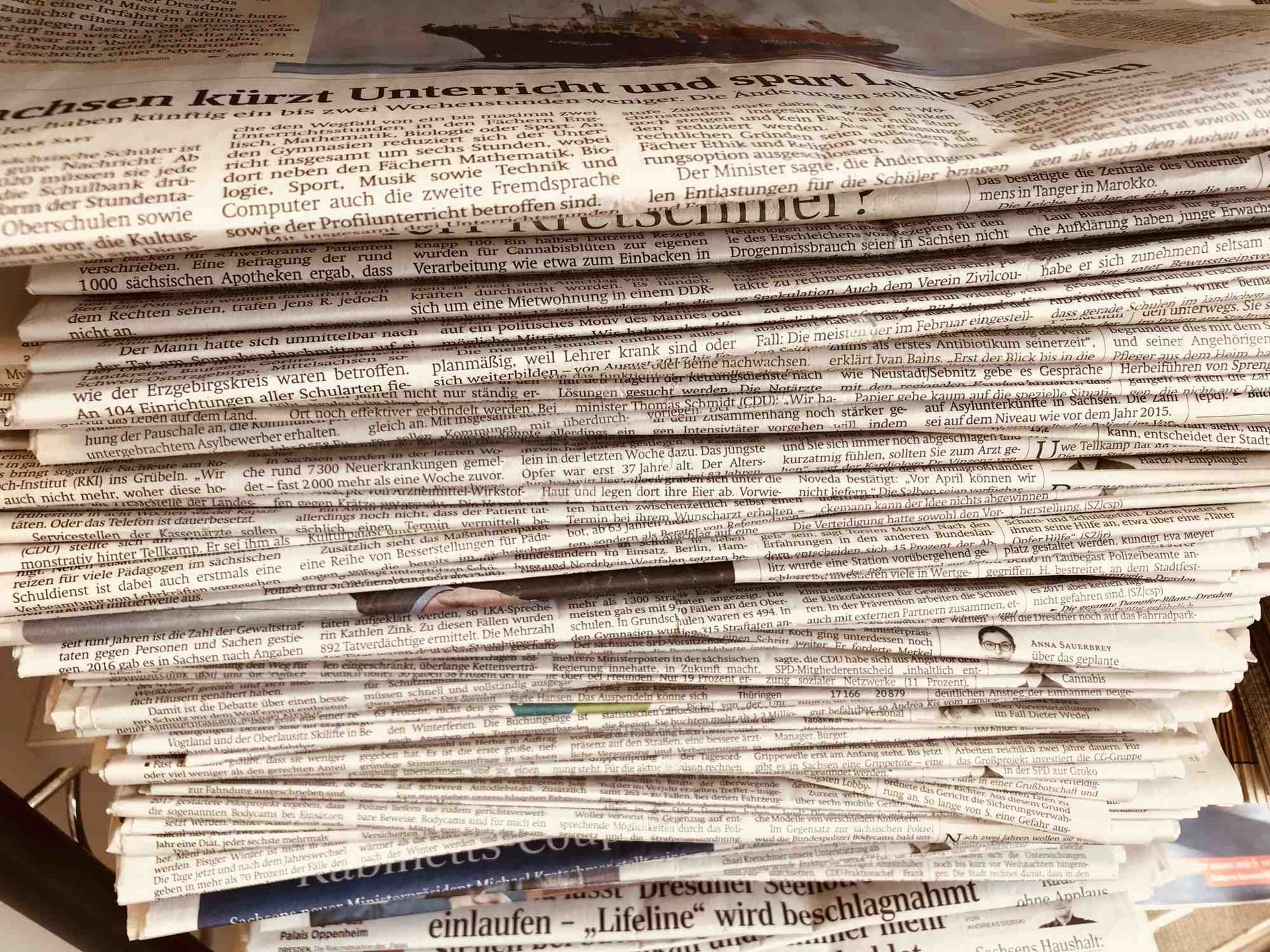 pile of newspapaers