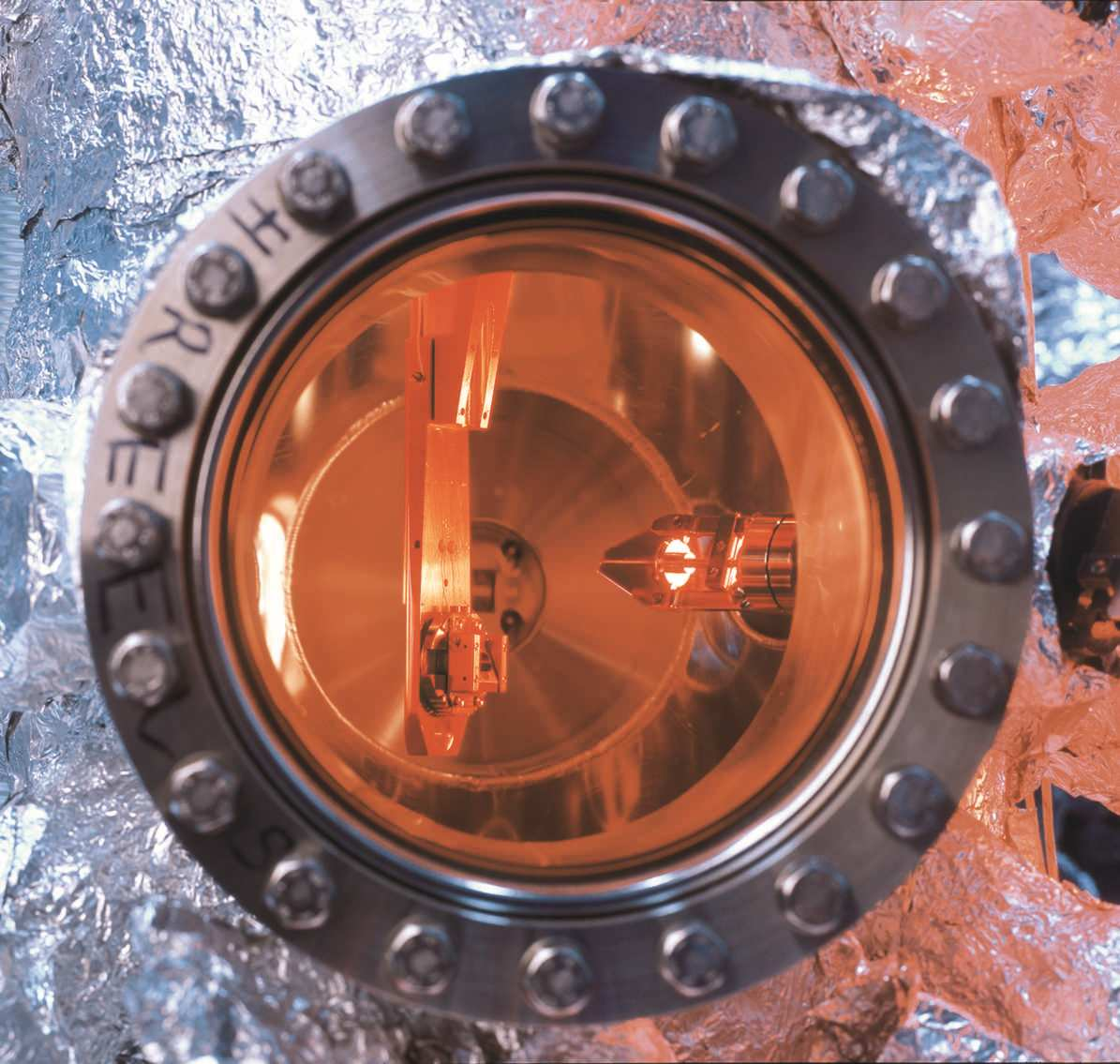 close look into a high vacuum chamber with complex device for smple movement and positioning